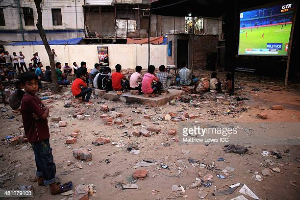 A young boy watches the New Zealand versus Netherlands match during the ICC World Twenty20 Bangladesh 2014 in the Old Town on March 29 2014 in Dhaka...