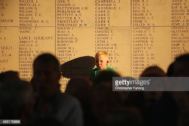 A young boy watches the playing of the Last Post at the Menin Gate Memorial to the Missing on August 4 2014 in Ypres Belgium Today marks the 100th...