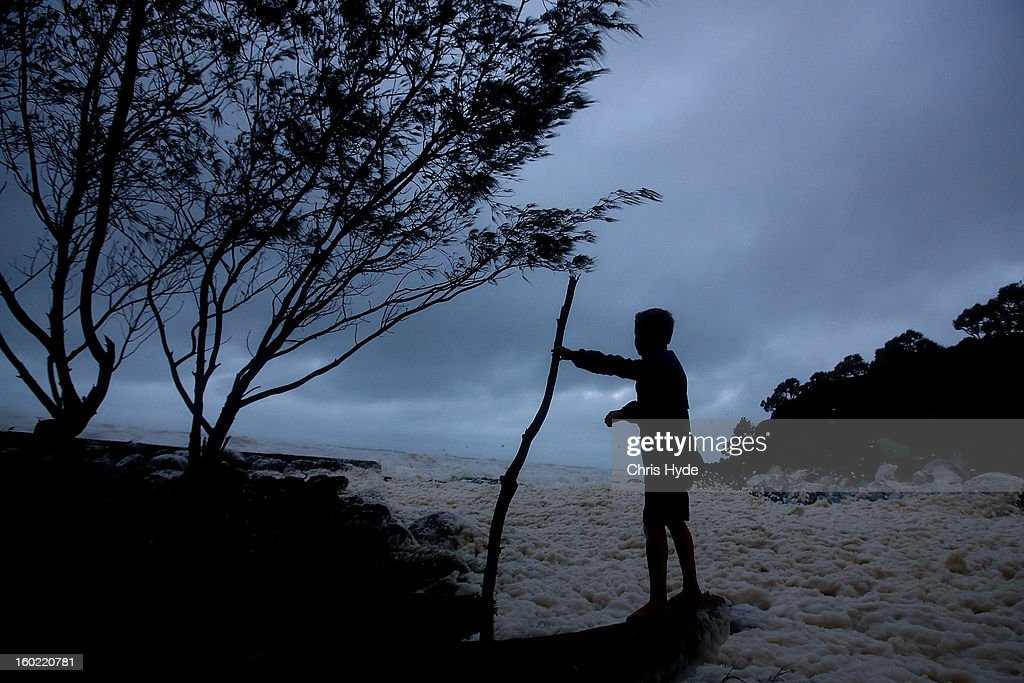 A young boy watches wild conditions in Snapper Rocks as Queensland experiences severe rains and flooding from Tropical Cyclone Oswald on January 28, 2013 in Gold Coast, Australia. Hundreds have been evacuated from the towns of Gladstone and Bunderberg while the rest of Queensland braces for more flooding.