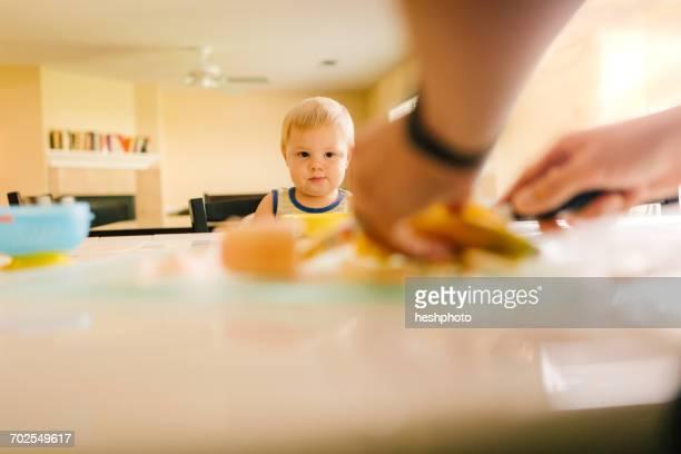 young boy watching father prepare food - heshphoto bildbanksfoton och bilder