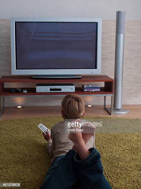 A young boy watching television