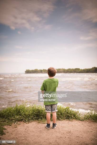 young boy watching the rapids - angela auclair stock pictures, royalty-free photos & images