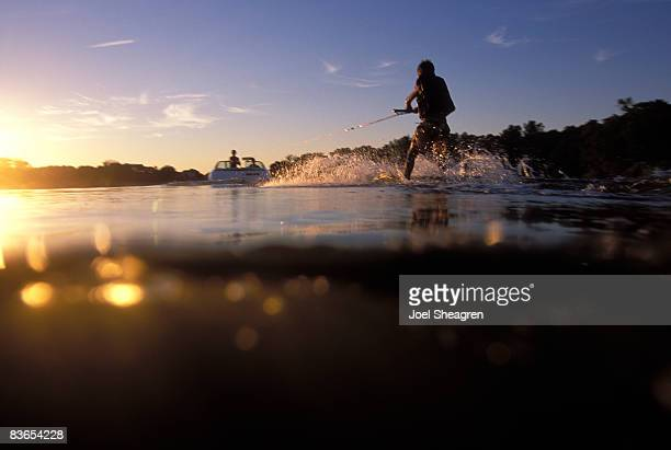 young boy water skiing. - waterskiing stock photos and pictures