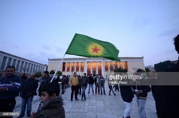 A young boy waves a Kurdish flag in the airKurdish people that live in Greece organise a demonstration in support of the struggle against ISIS in...