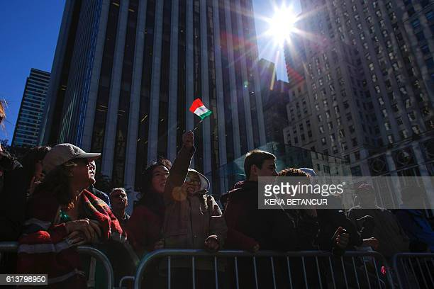 A young boy waves a little Italian flag during the annual Columbus Day parade in New York on October 10 2016 Columbus Day is a national holiday in...