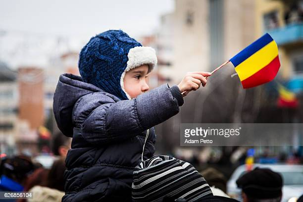 Young boy waving Romanian flag on Romania Unification Day