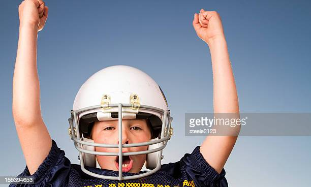 young boy wearing a football uniform - padding stock pictures, royalty-free photos & images