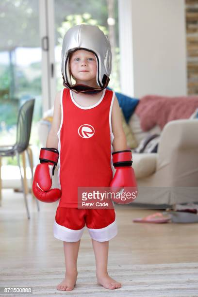 Young boy wearing boxing clothes