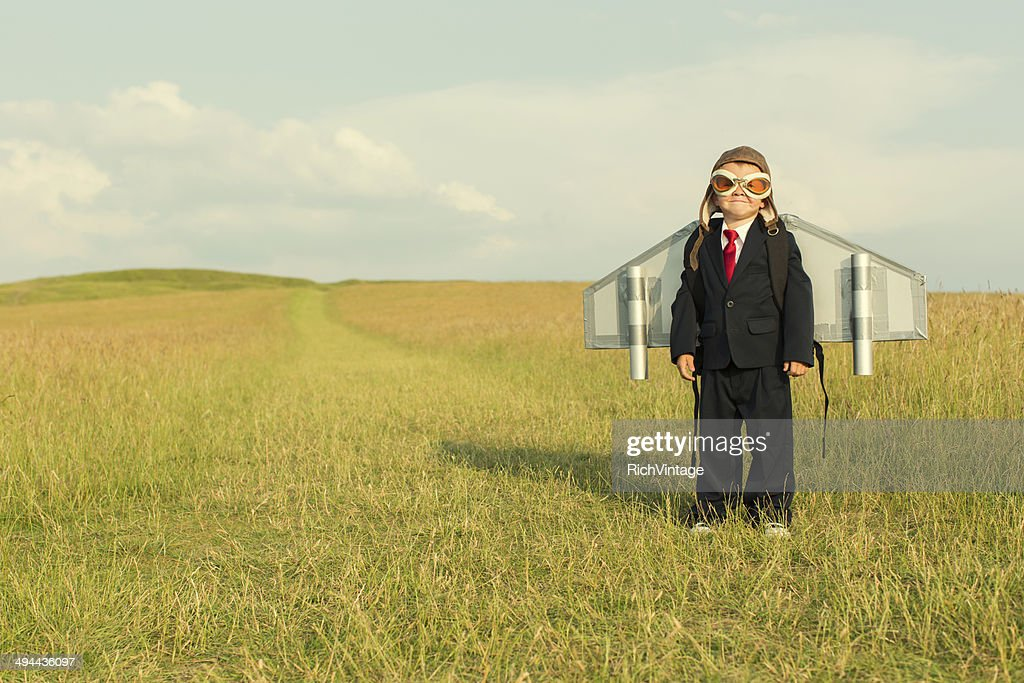 Young Boy Wearing Business Suit and Jetpack : Stock Photo