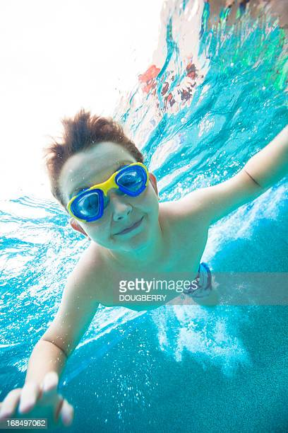 Young boy wearing goggles underwater