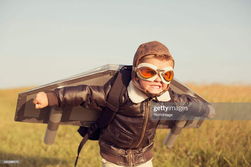 Young Boy wearing Jetpack is Taking Off : Stock Photo