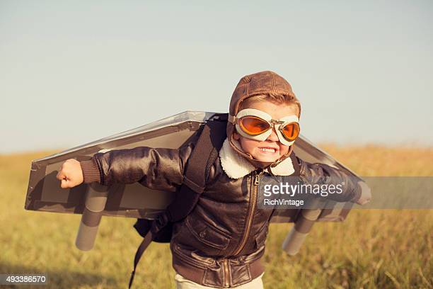 young boy wearing jetpack is taking off - piloting stock pictures, royalty-free photos & images