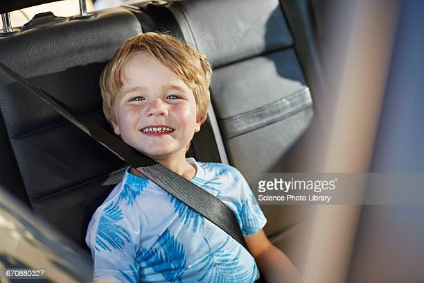 Young boy wearing seat belt