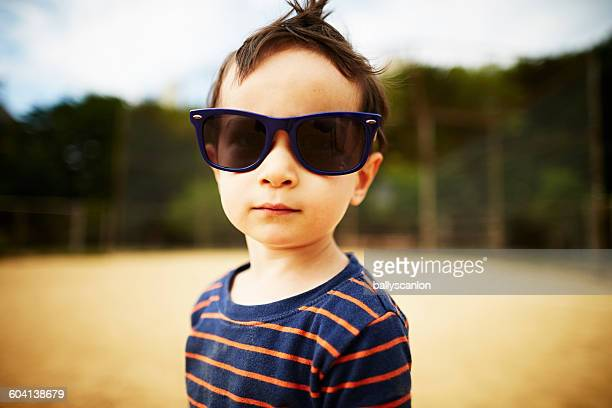 Young boy wearing sunglasses at park