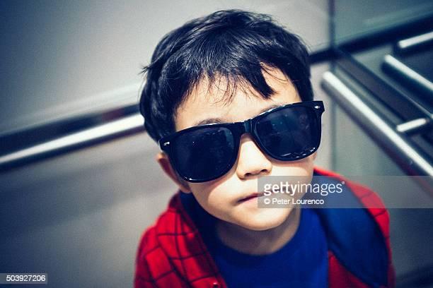 Young boy wearing sunglasses