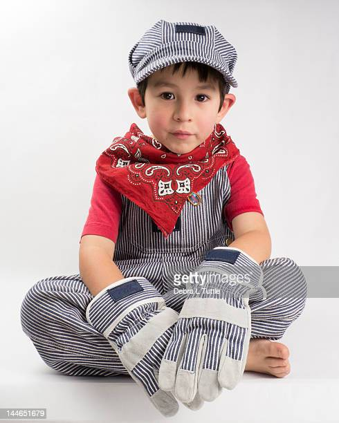 young boy wearing train engineer costume - kids costume engineer stock photos and pictures