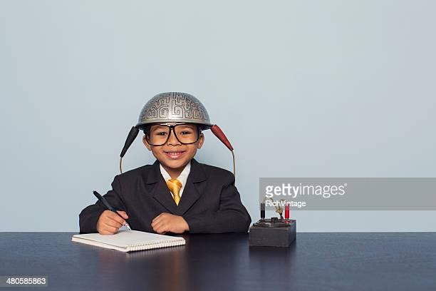 Young Boy Wears Brain Helmet Looking for Ideas