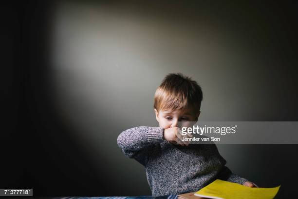 young boy wiping nose with hand - rubbing stock pictures, royalty-free photos & images