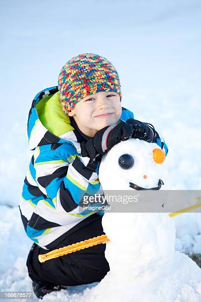 young boy with a funny snowman - ugly boys photos stock photos and pictures