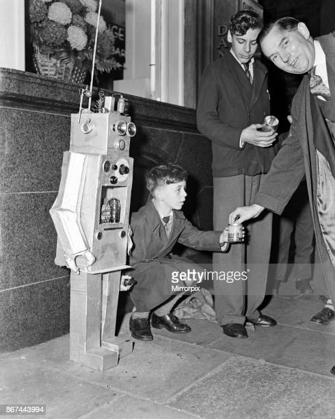 A young boy with a robot guy 8th October 1957
