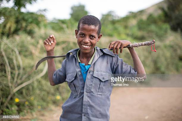 A young boy with a sickle on October 13 2015 in Mahoni Ethiopia