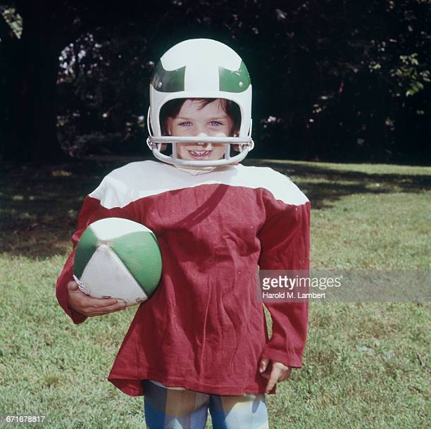 Young Boy With American Football.