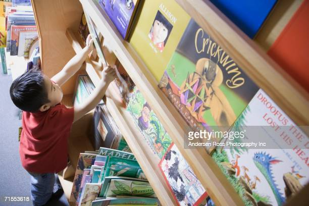 Young boy with book at bookstore