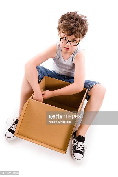 young boy with box