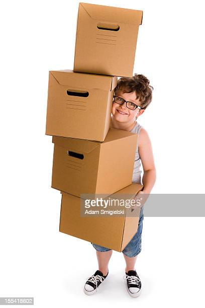 young boy with boxes