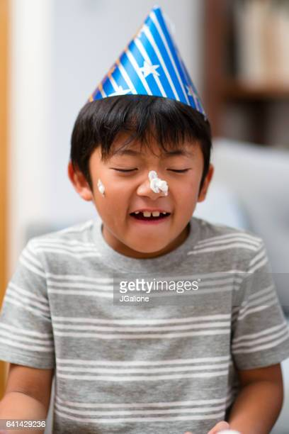 Funny birthday images free stock photos and pictures getty images young boy with cake on his nose voltagebd Gallery