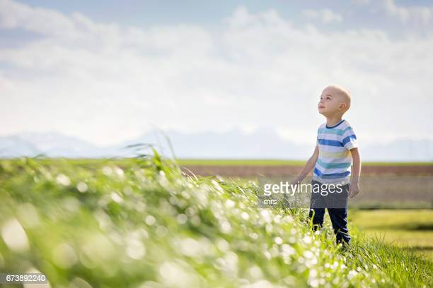 Young boy with cancer outdoors
