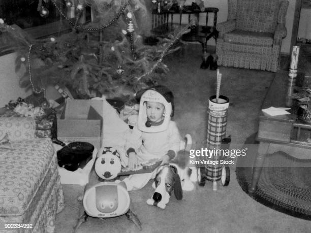Young boy with Christmas gifts, ca. 1964.