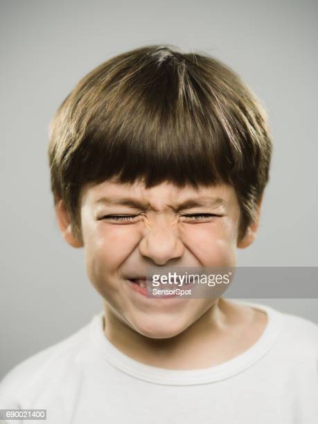 Young boy with disgust facial expression