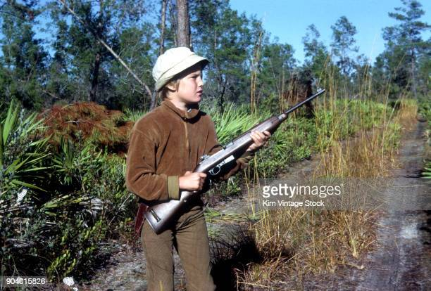 Young boy with first rifle, ca. 1967.