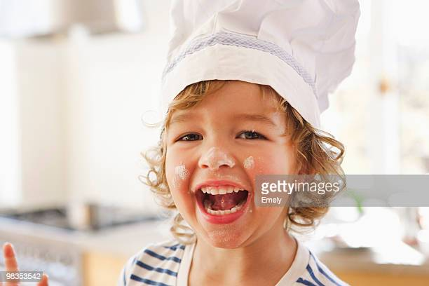 Young boy with flour in his face