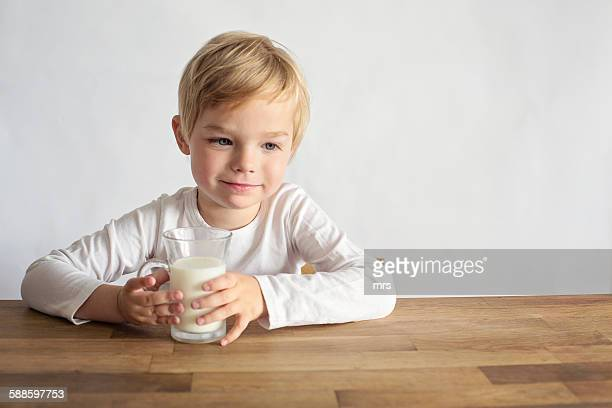 Young boy with glass of milk