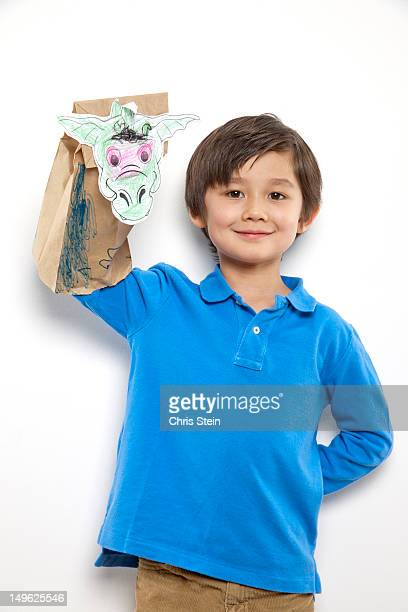 Young Boy with handcrafted Dragon