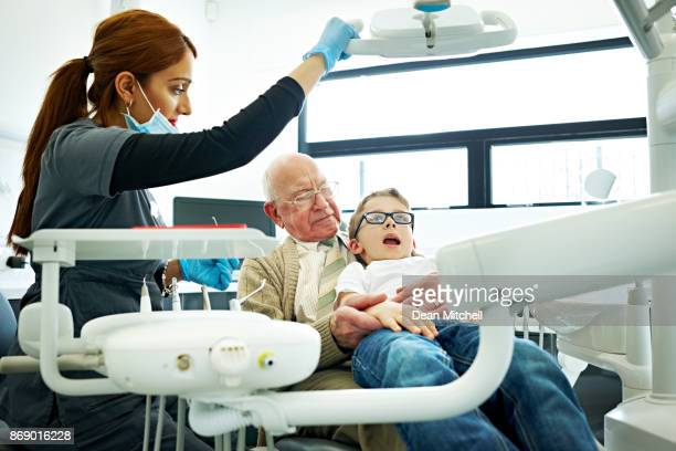 Young boy with his grandfather for a dental check-up