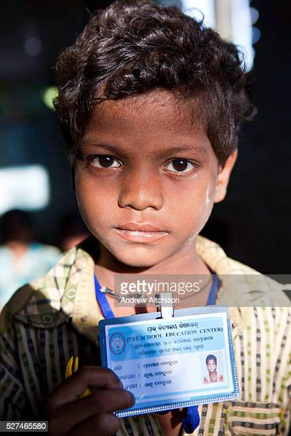 A young boy with his school identity card organised by CLAP Committee for Legal Aid to Poor is a nonprofit organisation helping to provide legal aid...