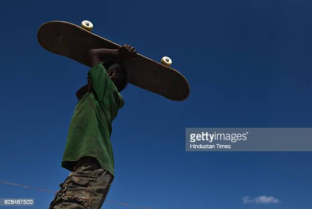 Young boy with his skateboard at Skating park, popularly known as Janwaar Castle on October 26, 2016 in Janwaar, India. Thanks to a German community...