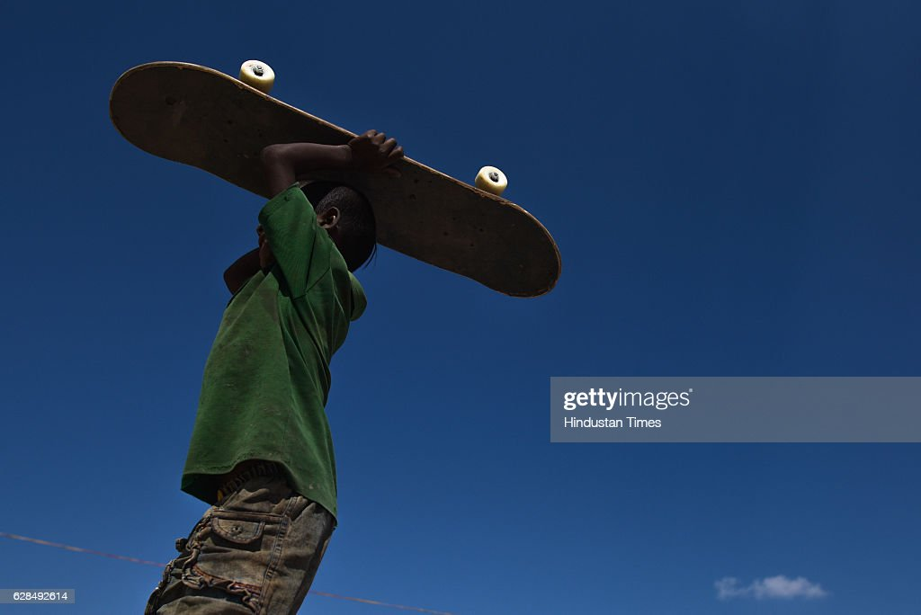 A young boy with his skateboard at Skating Park, popularly known as Janwaar Castle, on October 26, 2016 in Janwaar, India. Thanks to a German community activist and author Ulrike Reinhard, skateboarding is slowly changing the children in this Madhya Pradesh village divided by caste. Located along the fringes of the Panna National Tiger Reserve, the Janwaar Skating Park is a not-for-profit project that teaches village children skateboarding free of cost. The park is a place for unfettered fun, but has two strict ground rules. Rule number one: Girls first. And rule number two: No school, no skateboarding. The park also bridges caste disparities by bringing together the village Adivasi and upper caste Yadav and Kushwaha children to play together.