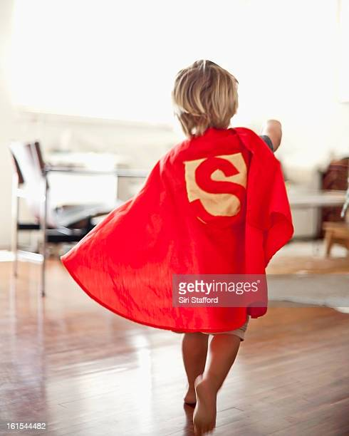 Young boy with homemade cape