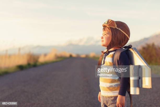 young boy with jet pack dreams of flying - innovation stock pictures, royalty-free photos & images