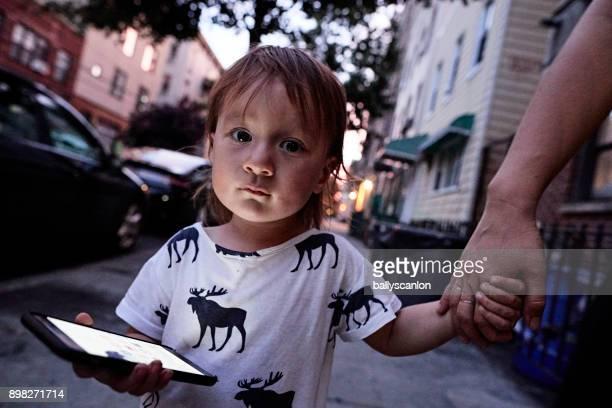 young boy with mobile phone. - holding hands in car stockfoto's en -beelden