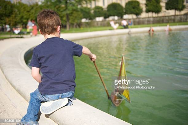 Young boy with model boat