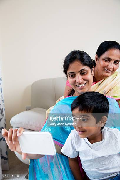 Young boy with mum and grandmother taking a selfie