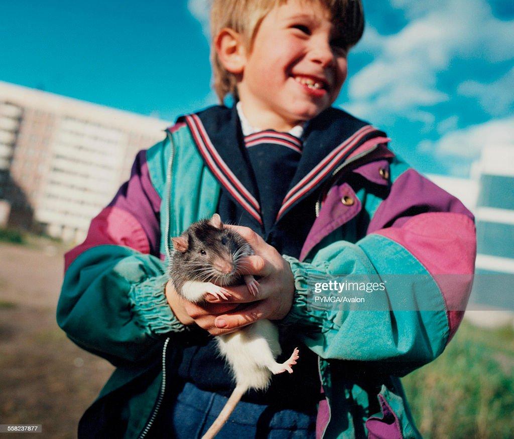 Young boy with pet rat, St Petersburg : News Photo
