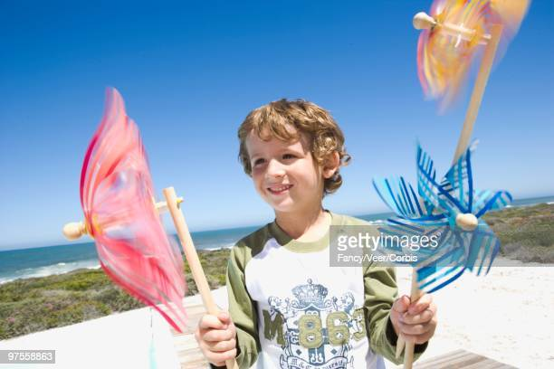 Young boy with pinwheels