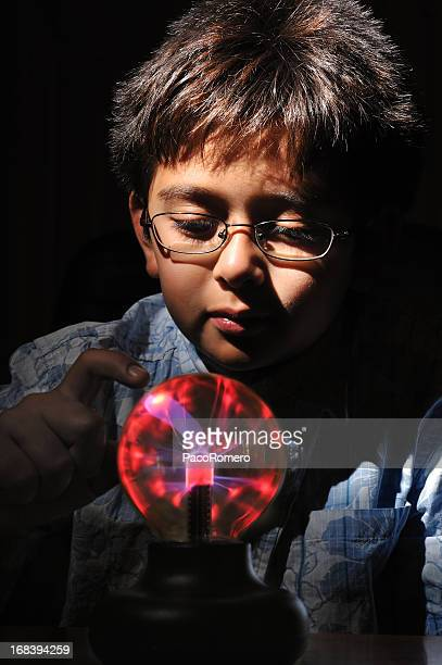 Young boy with plasma lamp toy