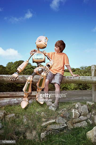 young boy with robot companion - coneyl stock pictures, royalty-free photos & images